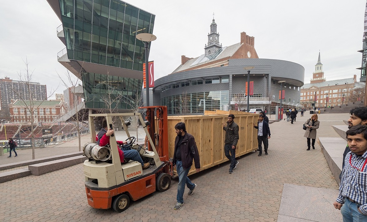 Hyperloop UC team members escort a crated protype across campus.