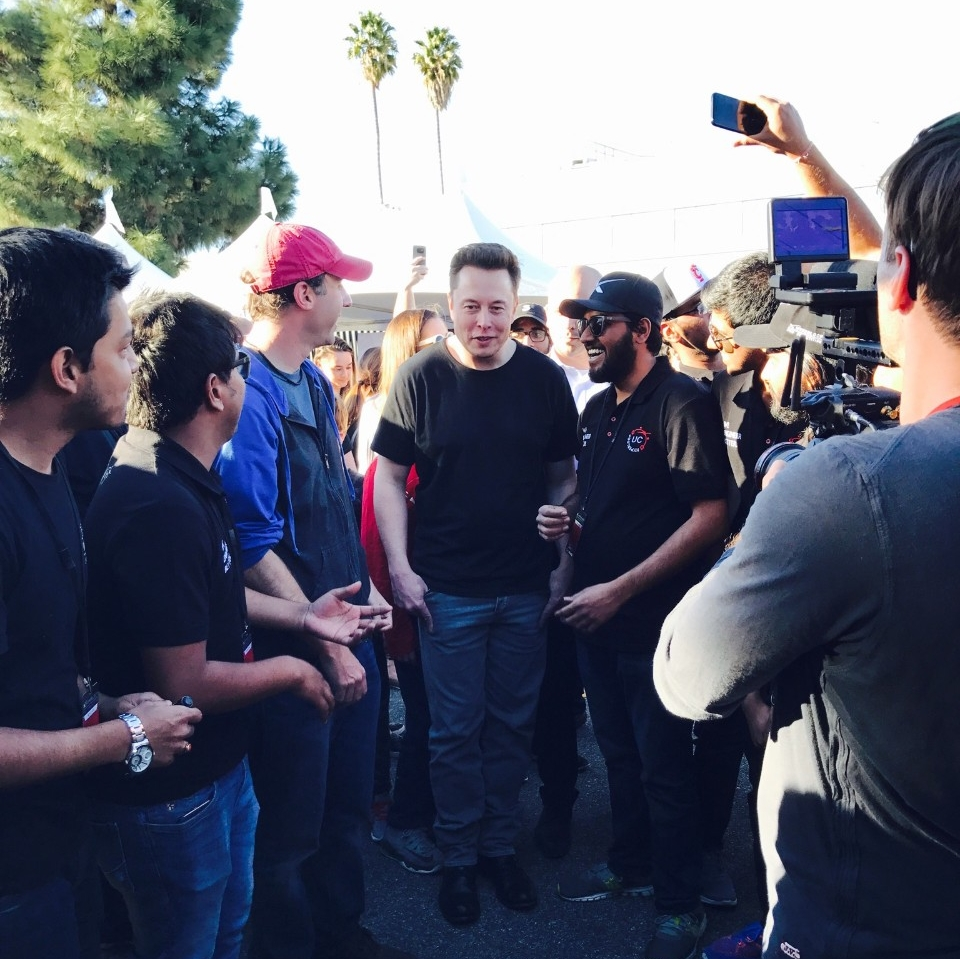 Elon Musk visits UC student and team captain Dhaval Shiyani at the Hyperloop UC display tent during Competition Weekend. photo/Siddharth Sridhar