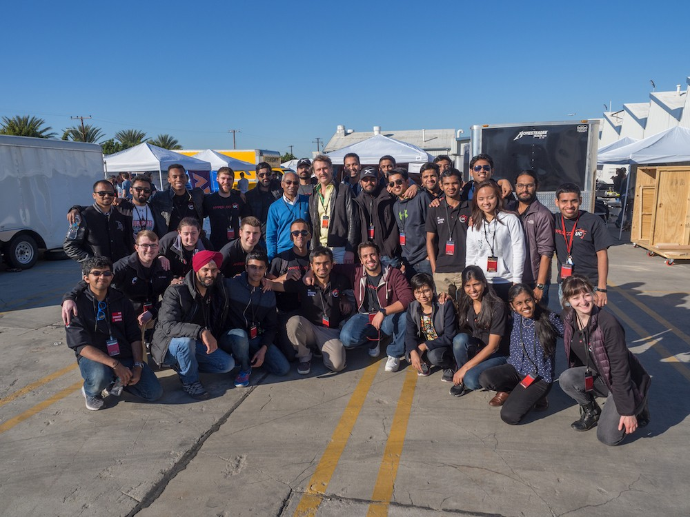 The Hyperloop UC team crowds around Brogan BamBrogan (center). photos/Jay Yocis